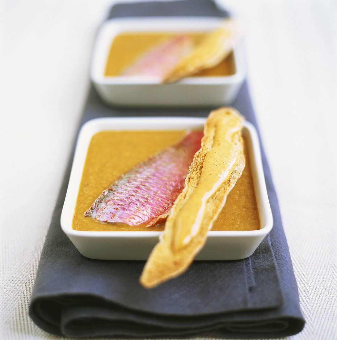 Pureed fish soup, above, red mullet and bread stick