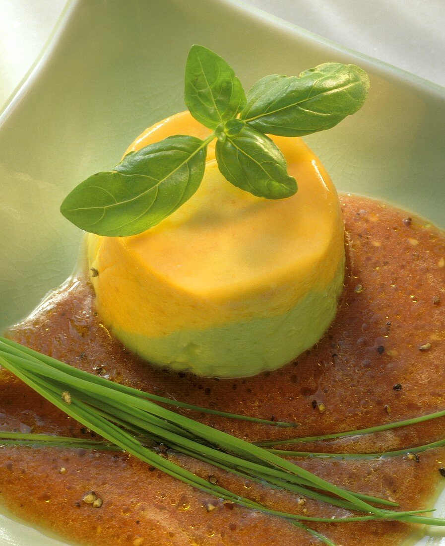 Pepper mousse on tomato sauce with chives