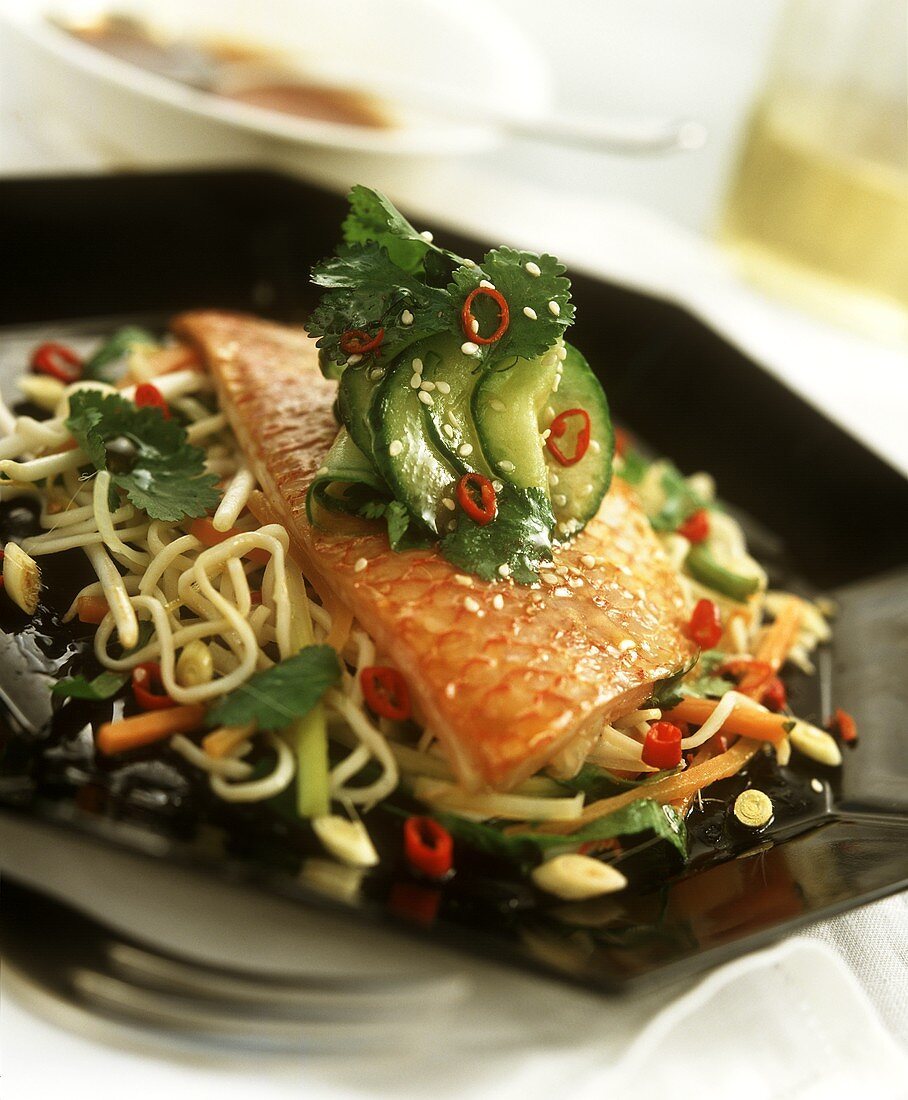 Red perch on sesame noodles and vegetables