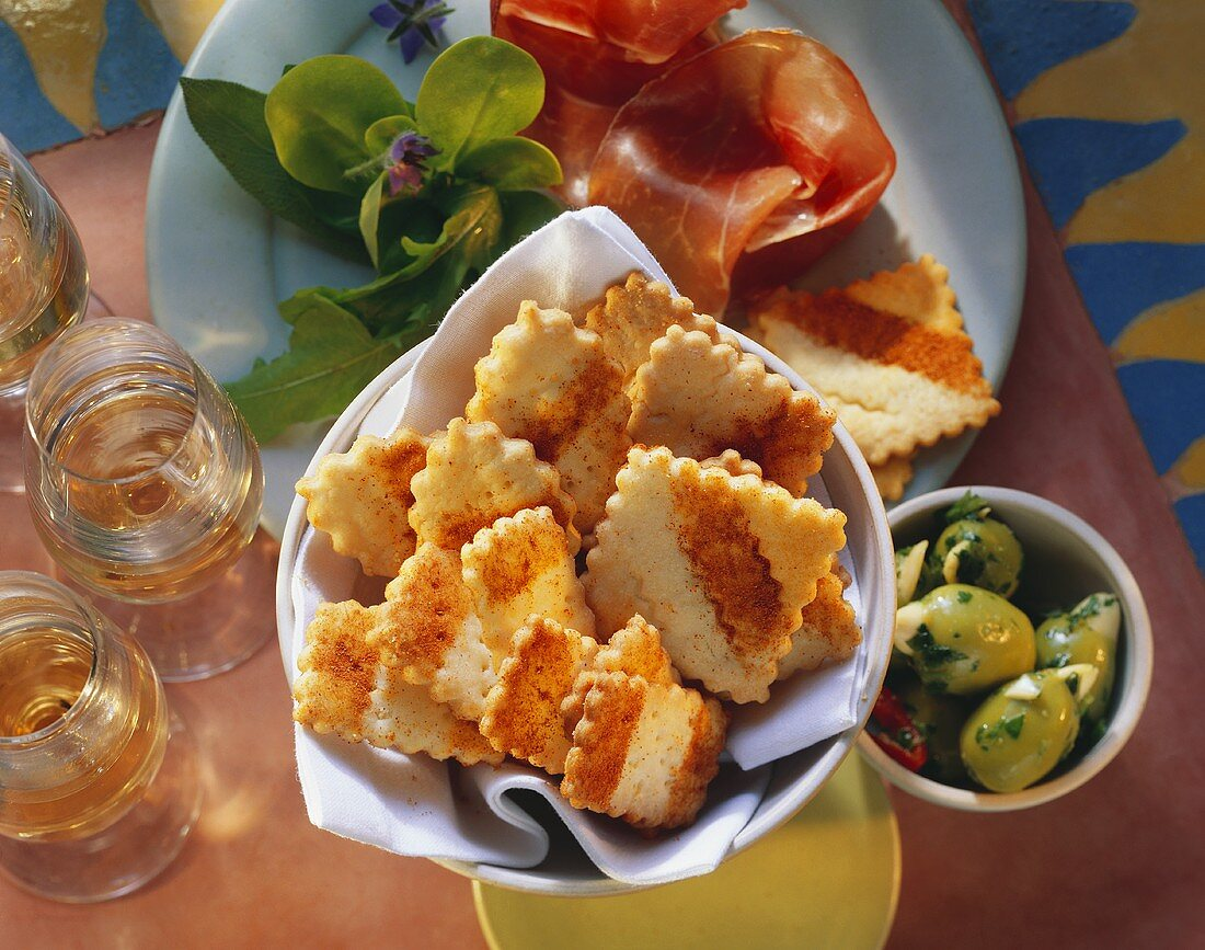 Spanish cheese cracker, with olives and ham