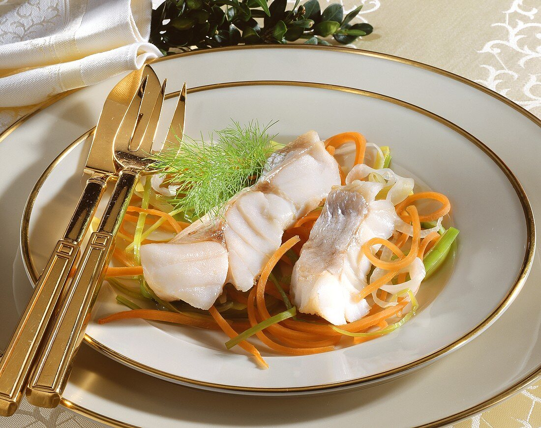 Poached red perch on vegetable strips