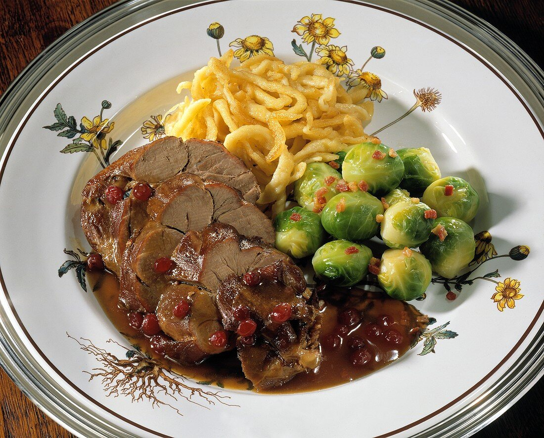Sweet & sour leg of hare with Brussels sprouts & noodles