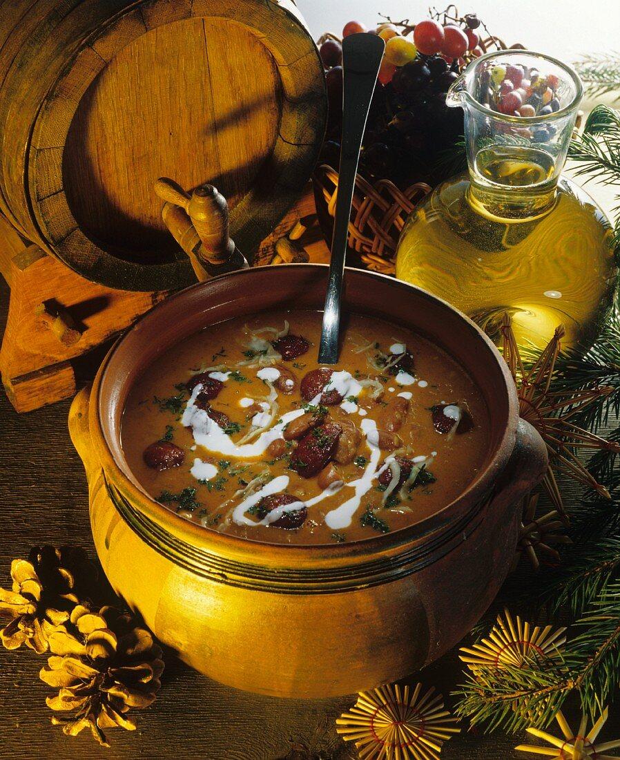 Bean soup with sauerkraut and sausage