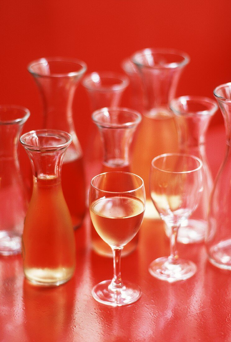 White wine in several carafes and a glass