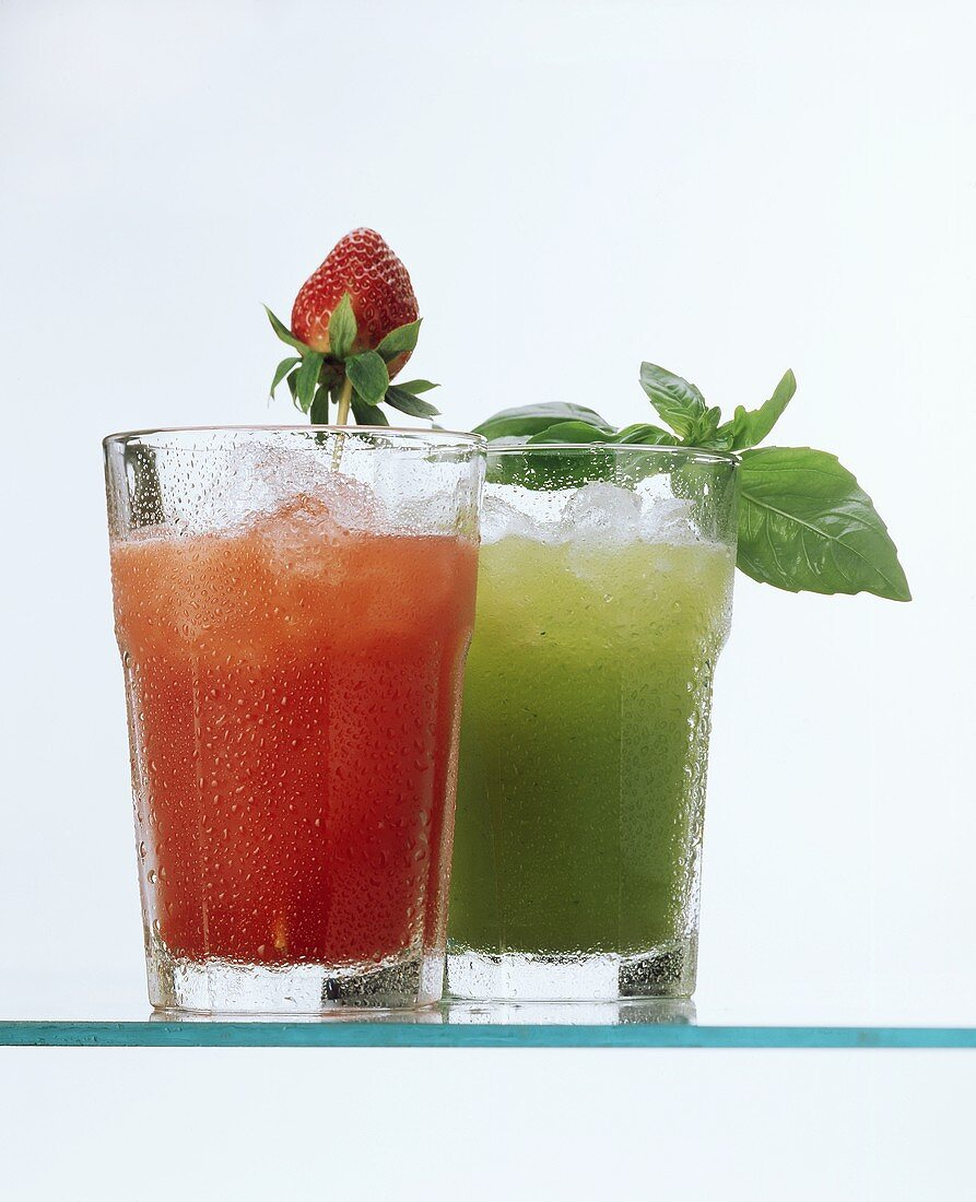 Two cold non-alcoholic fruit drinks