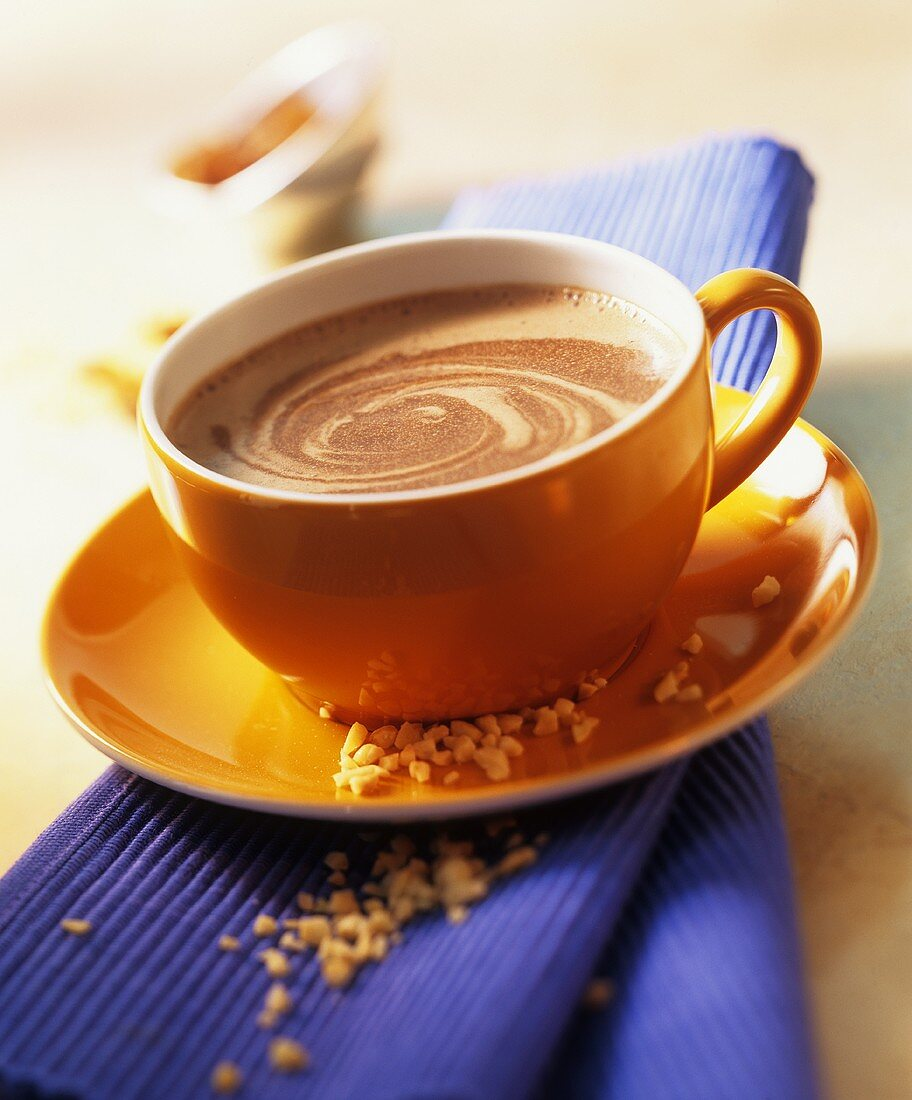 Cocoa with a shot, powdered ginger, almonds & raisins
