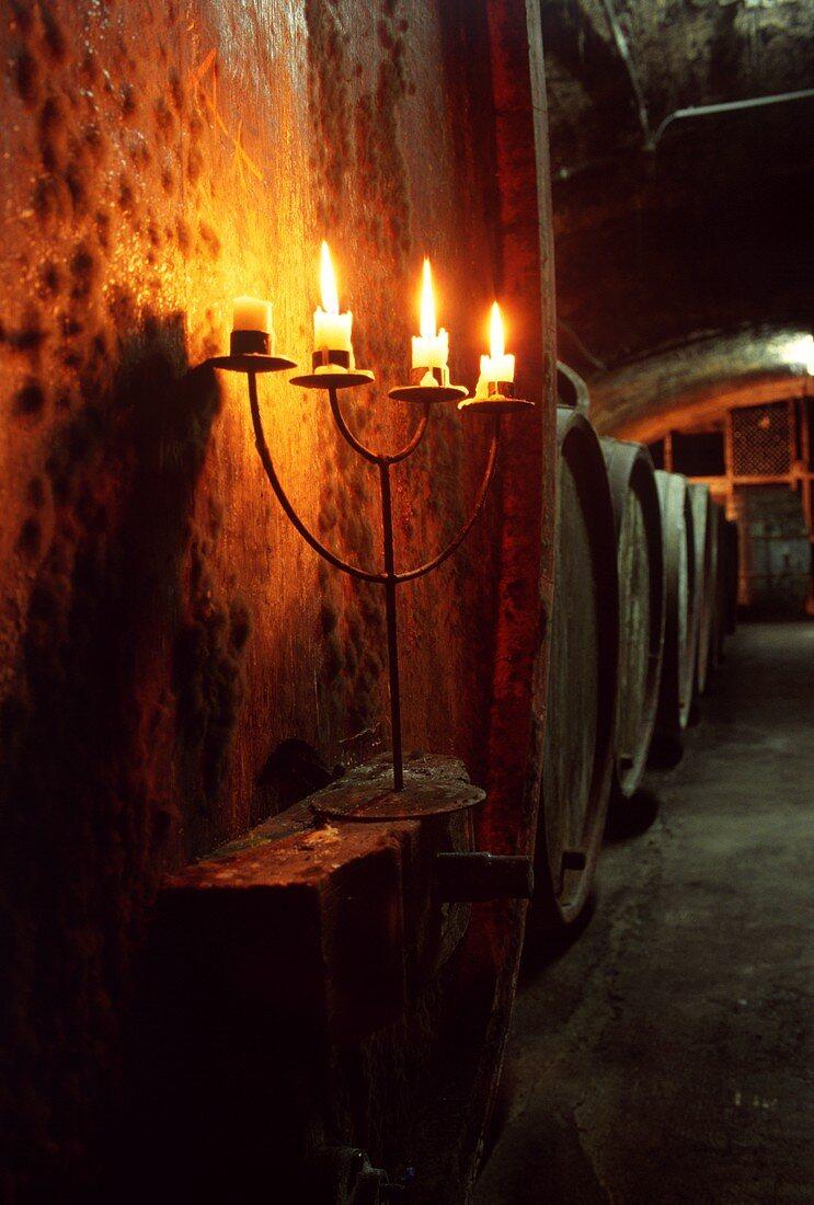 Candlestick on wine barrel in wine cellar, Winzerhof Gietzen