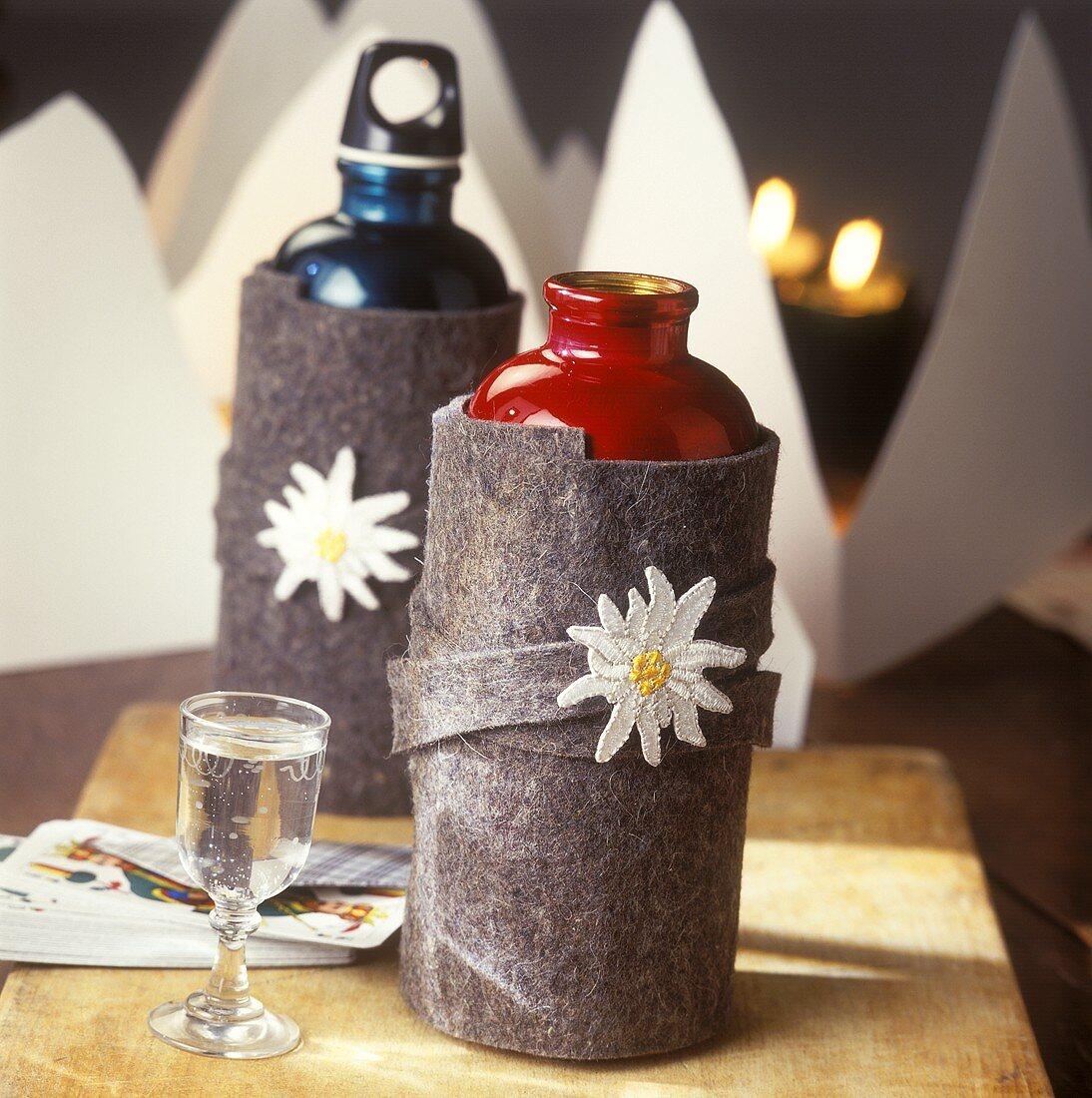 Sports bottles in felt case & schnapps glass, chalet evening