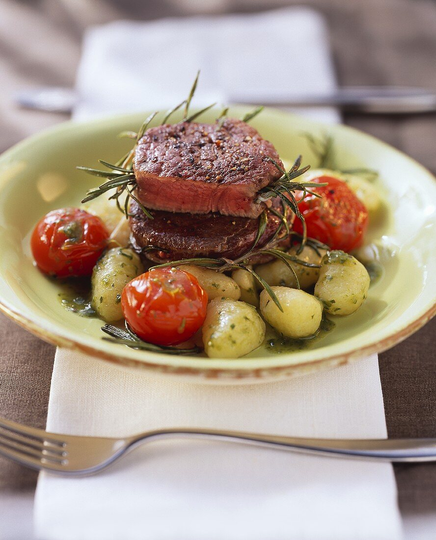 Ostrich medallions with rosemary on gnocchi