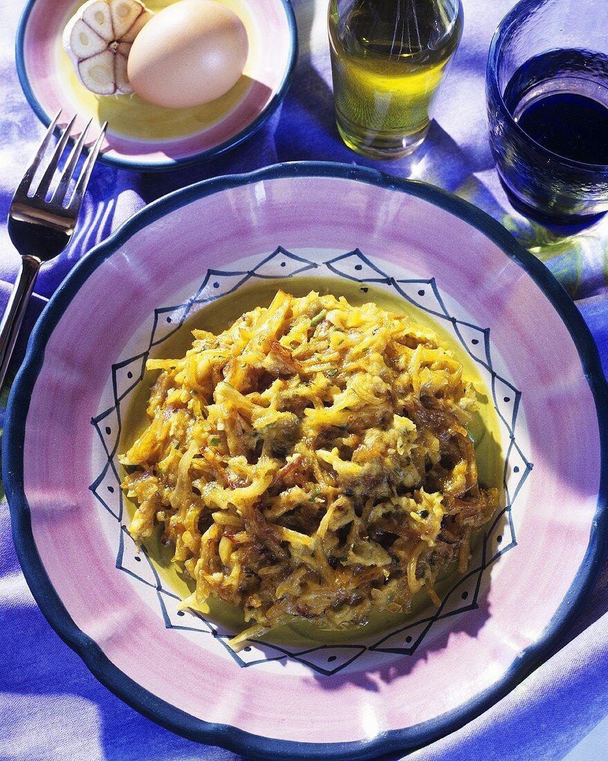 Stockfisch a la Bras (mit Zwiebeln, Kartoffeln und Ei)