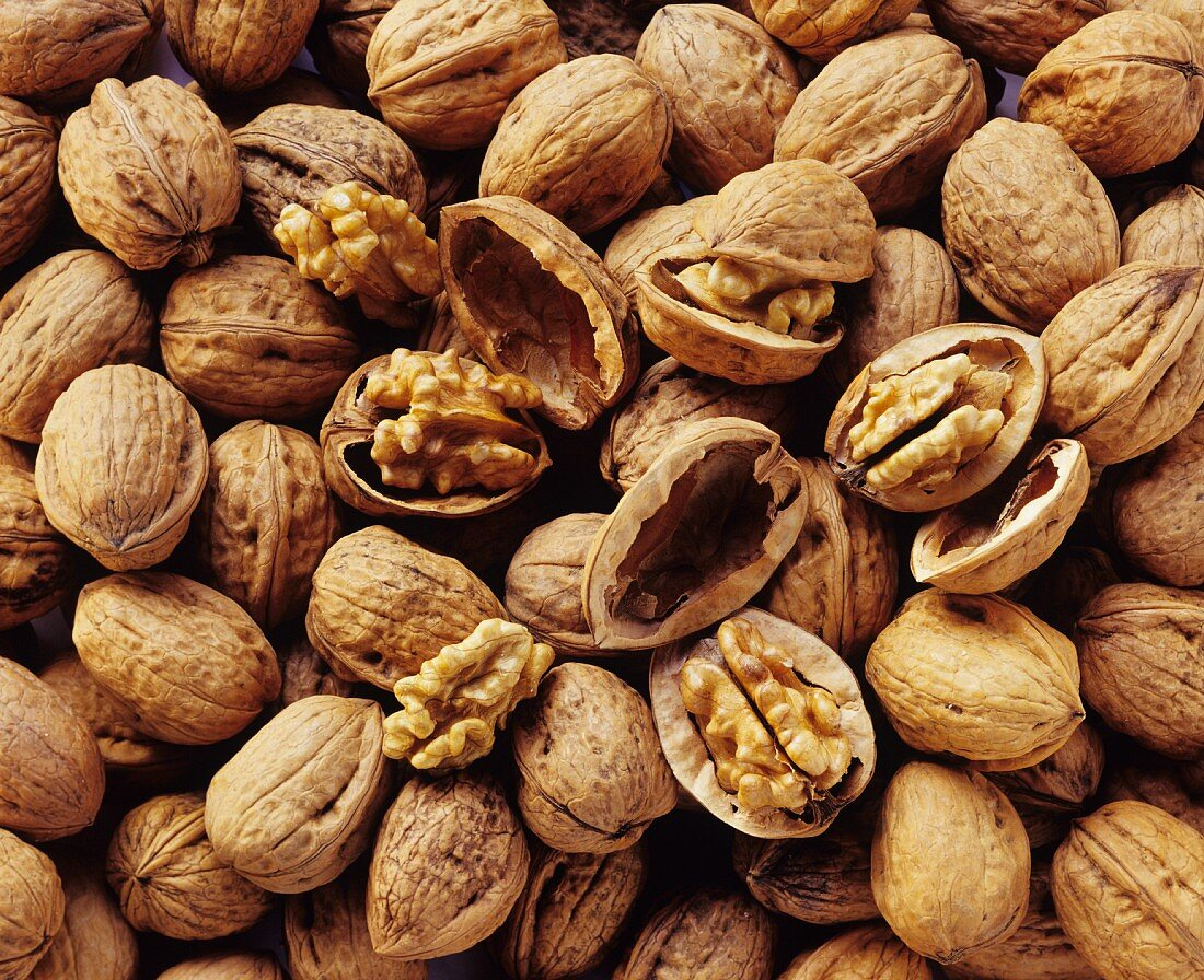 Walnuts with and without shells (filling the picture)