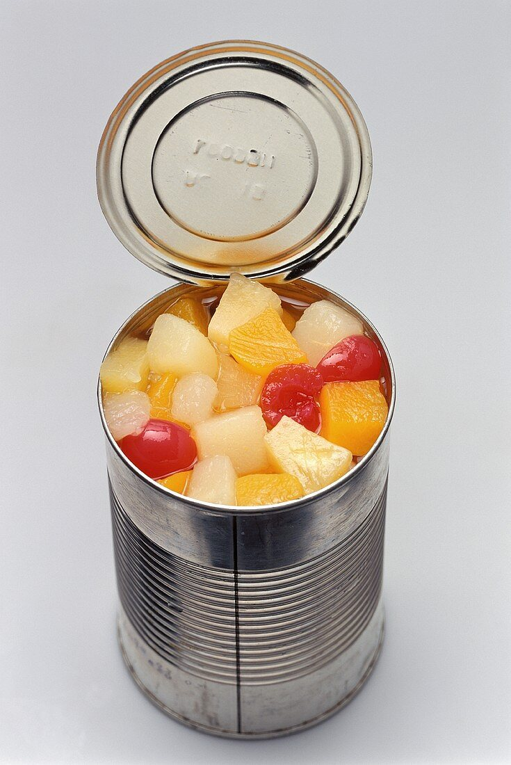 Mixed fruit in an opened tin