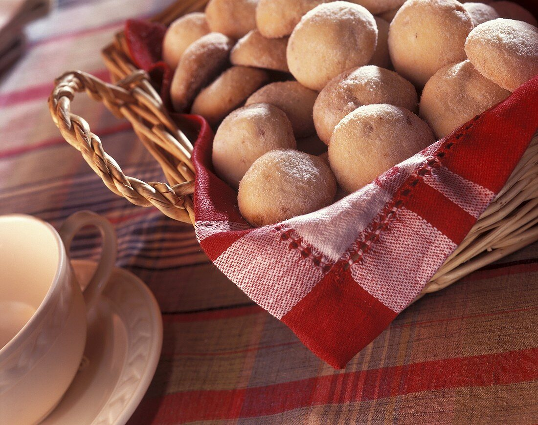 Polvorones (small Mexican cookies) in bread basket
