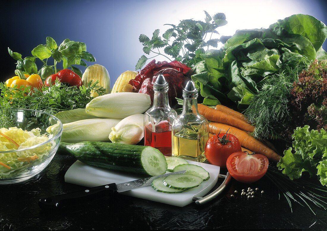Still life: salad ingredients- vegetables, herbs, vinegar,oil