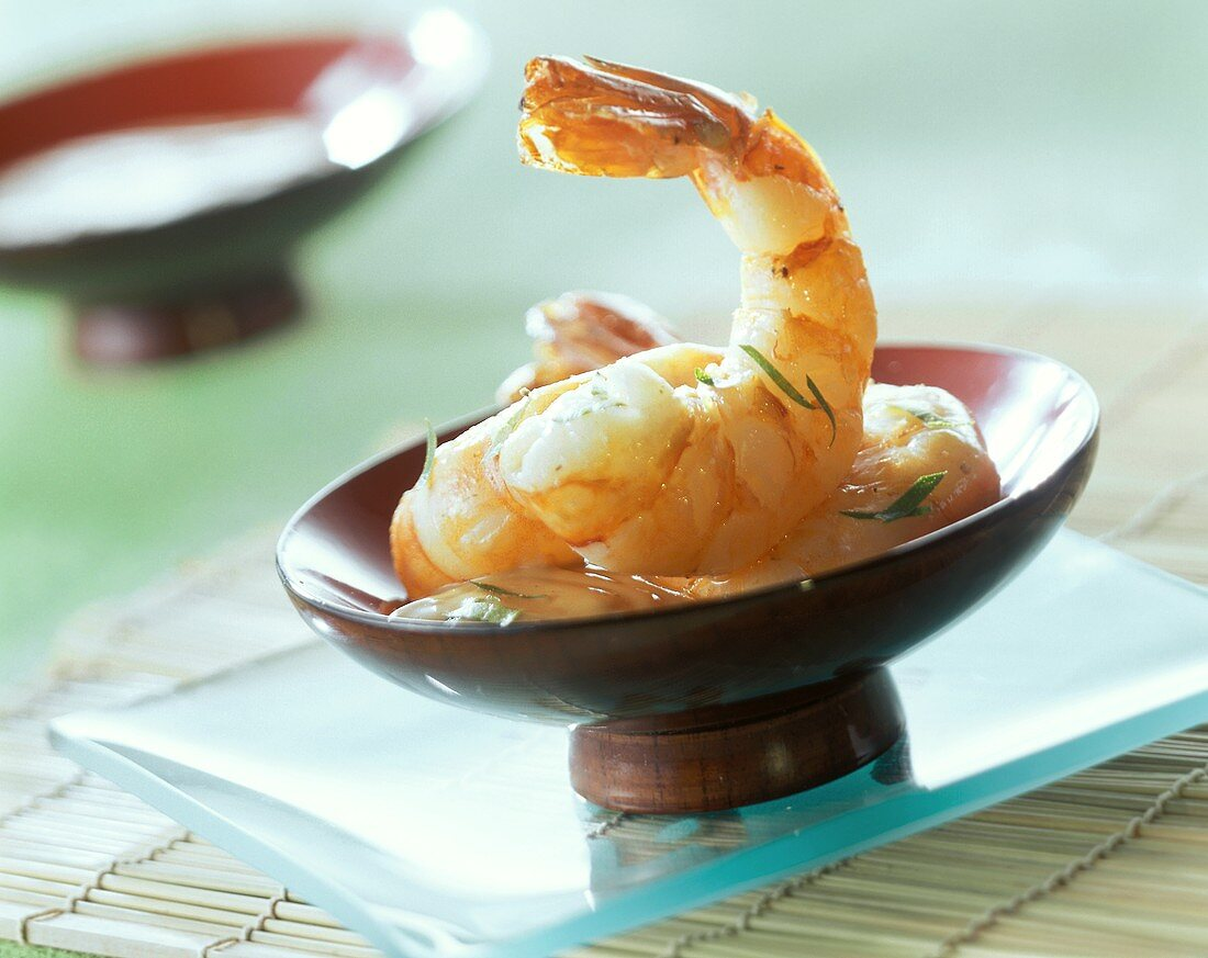 Jumbo prawns with spicy coconut sauce in a bowl