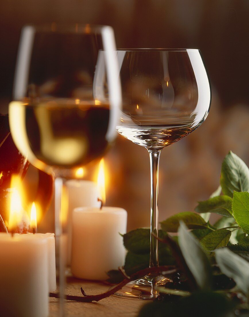 White wine glasses in candlelight