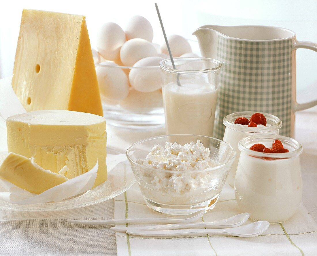 Still life with butter, cheese, yoghurt, milk and eggs