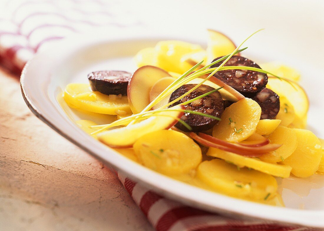 Swabian potato salad with black pudding and apple slices