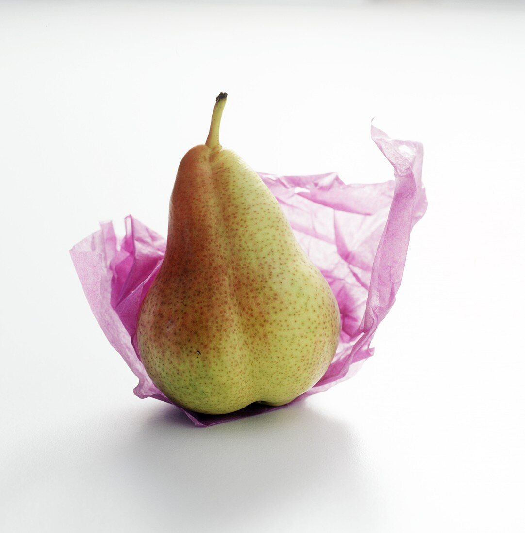 A Forelle Pear on Tissue Paper