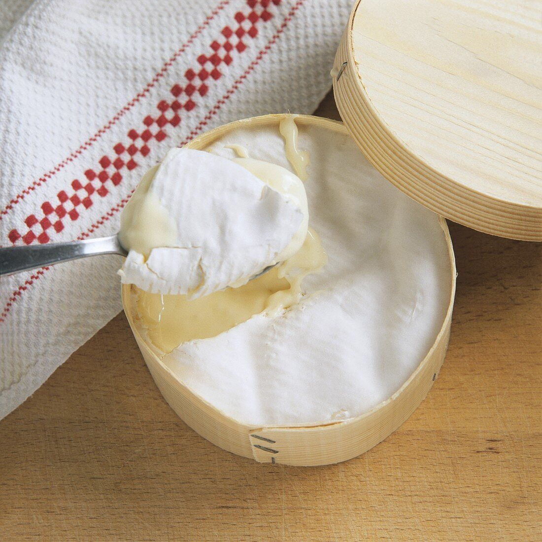 A Vacherin de Beauges in a wood chip box with spoon