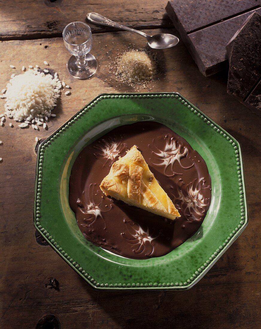 Torta di riso affogata (rice tart on chocolate sauce)