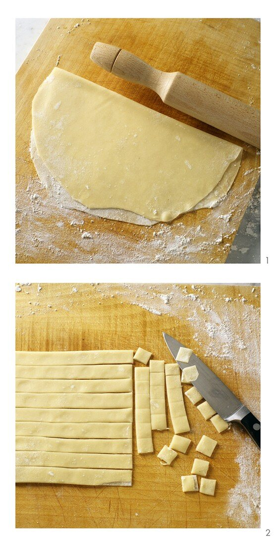 Rolling out pasta dough and cutting into small squares