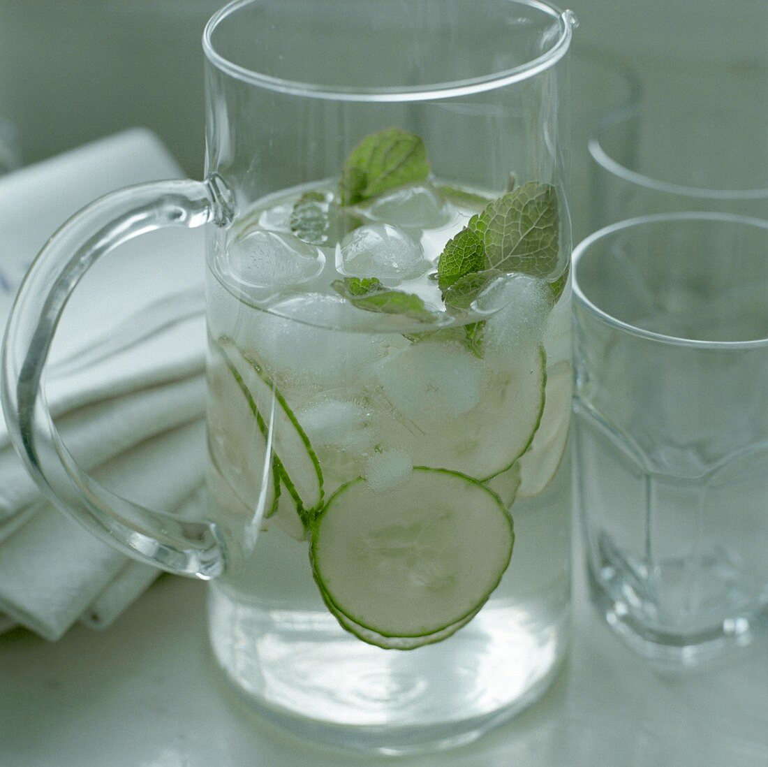 Refreshing drink with cucumber slices