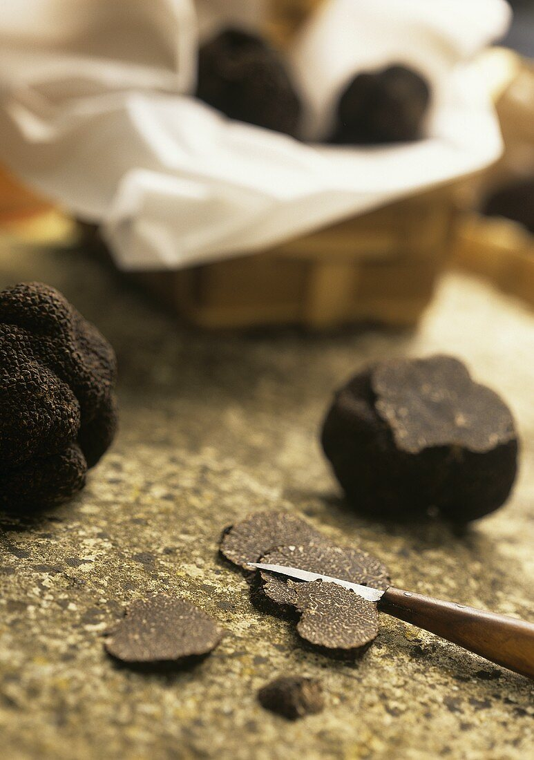Cutting black truffle into thin slices