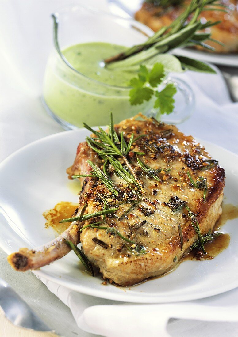 Fried pork chop with herbs and herb cream sauce