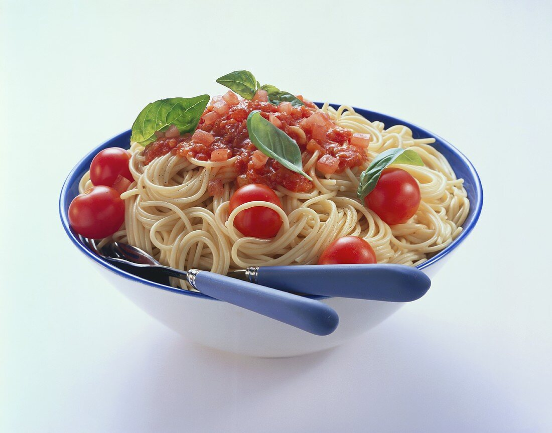 Spaghetti with tomato sauce and tomatoes in a dish