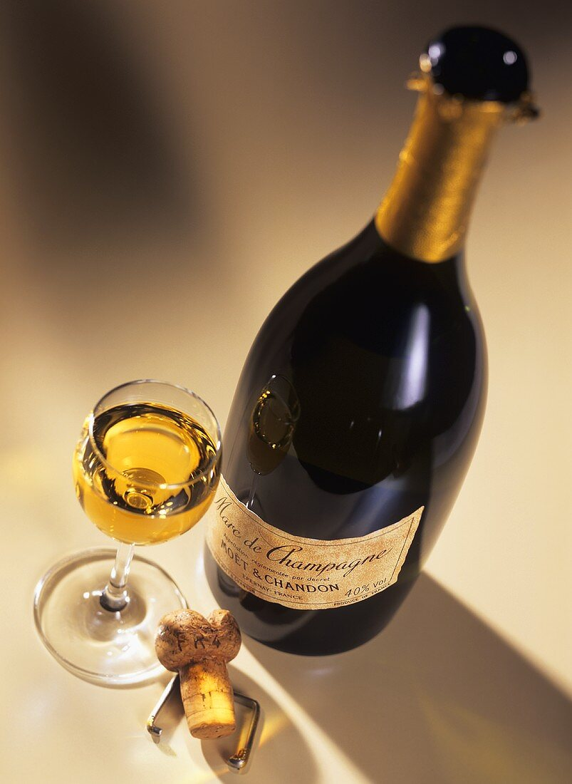 A glass of Marc de Champagne with bottle (Moet & Chandon)