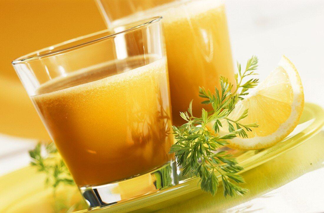 Multi-vitamin juice: bananas, oranges, lemons and carrots