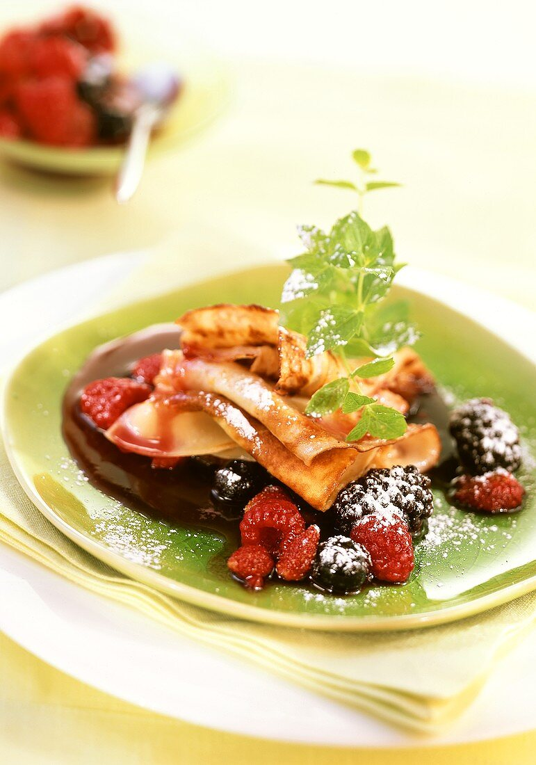 Flambéed crepes with forest fruit sauce
