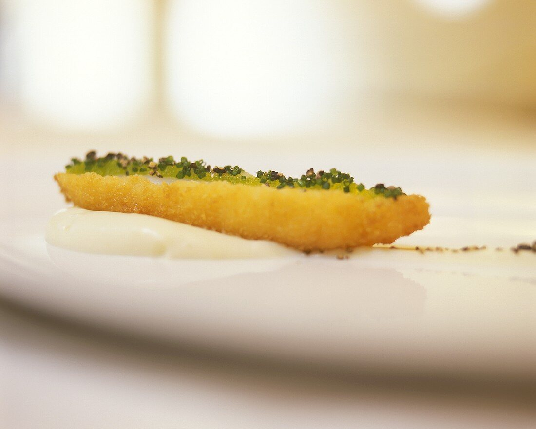 Deep-fried shrimp with wasabi caviare on cauliflower mousse