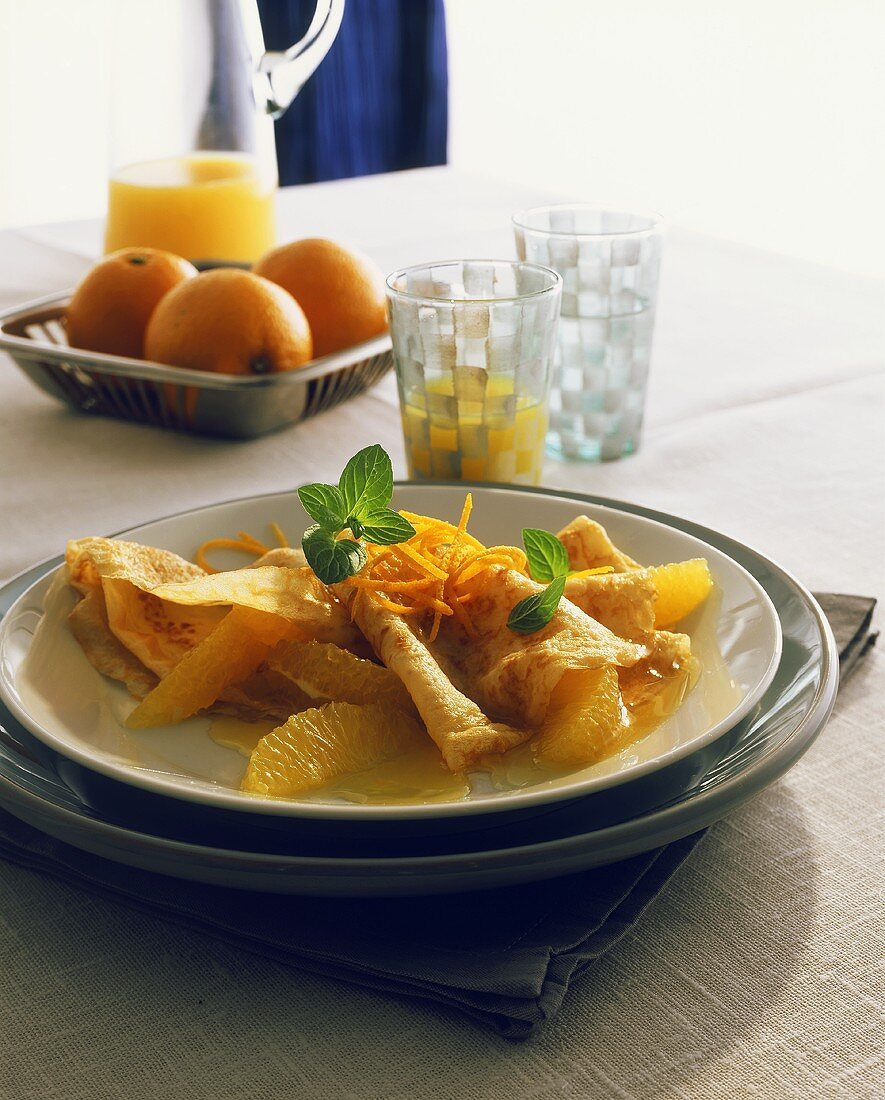 Crepes with oranges