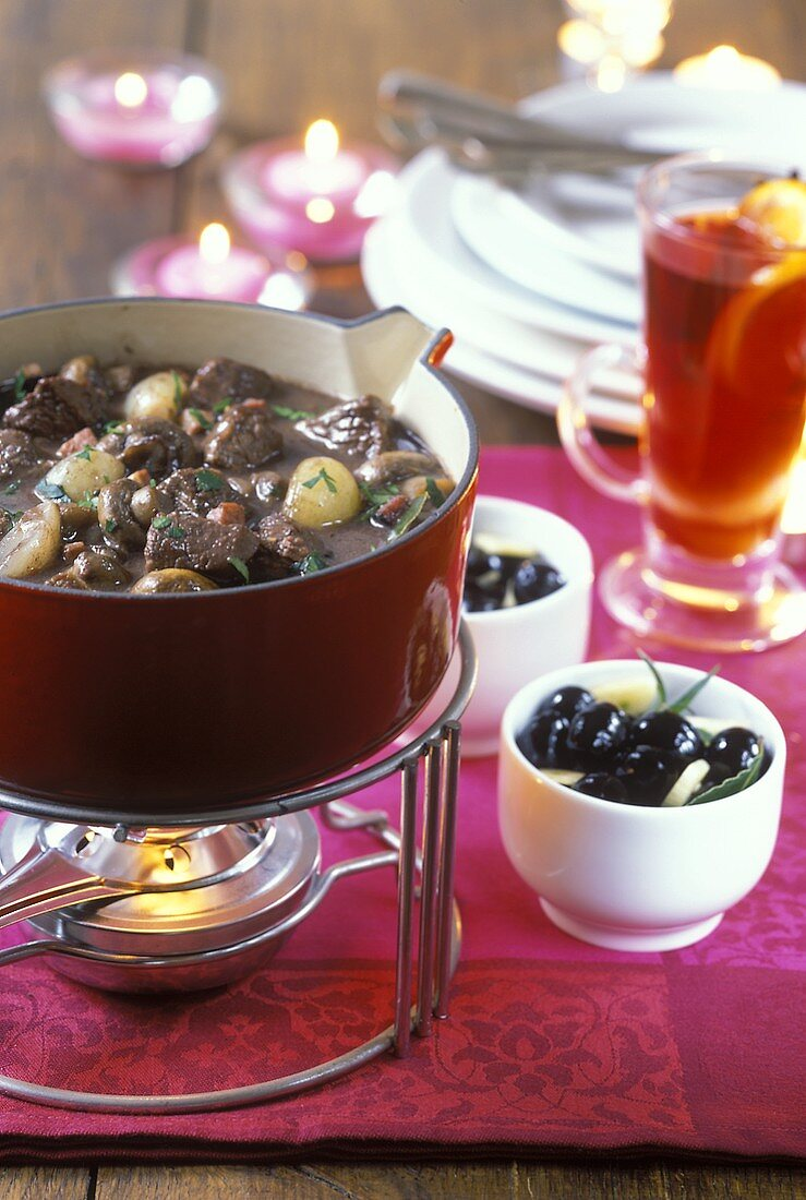 Beef ragout with red wine and button mushrooms