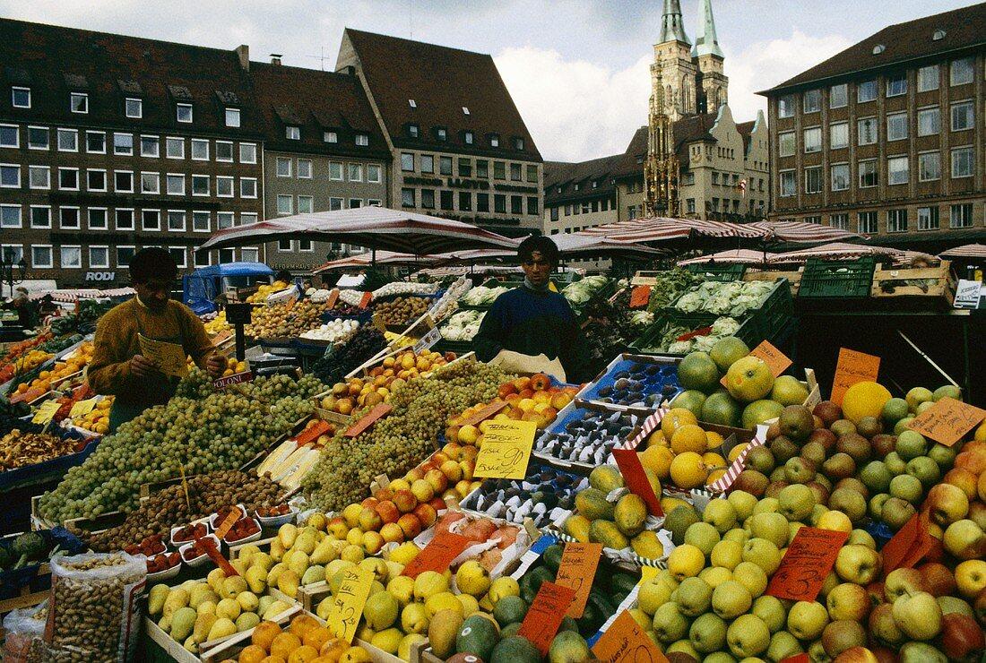 Overflowing fruit and vegetable stalls at Nuremberg market