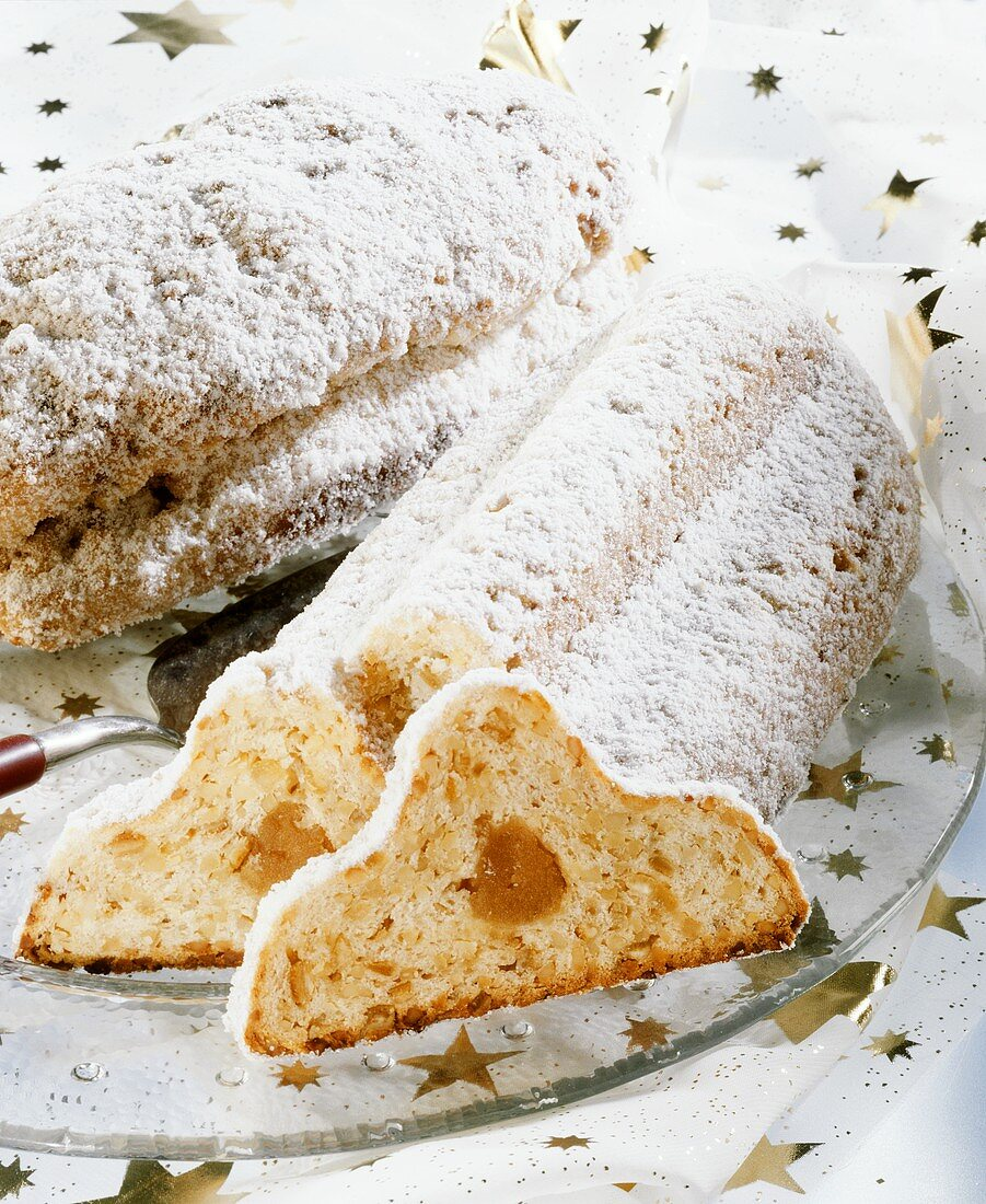 Christmas stollen with marzipan filling, a piece cut