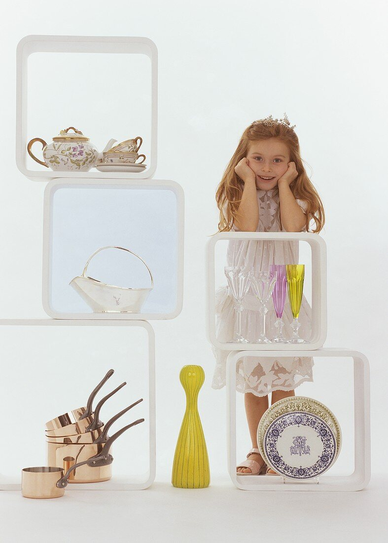 Girl in white dress with nostalgic domestic appliances