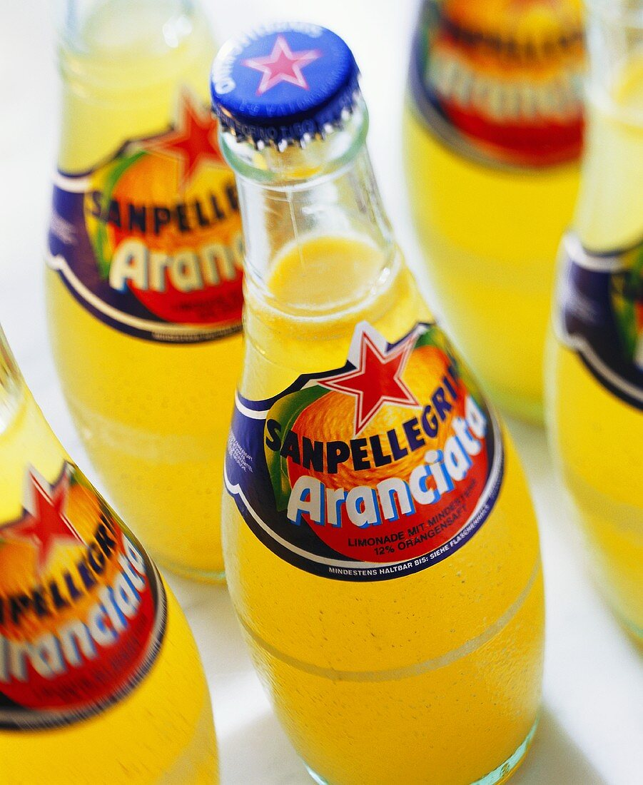 Small bottles of aranciata (Italian orangeade)