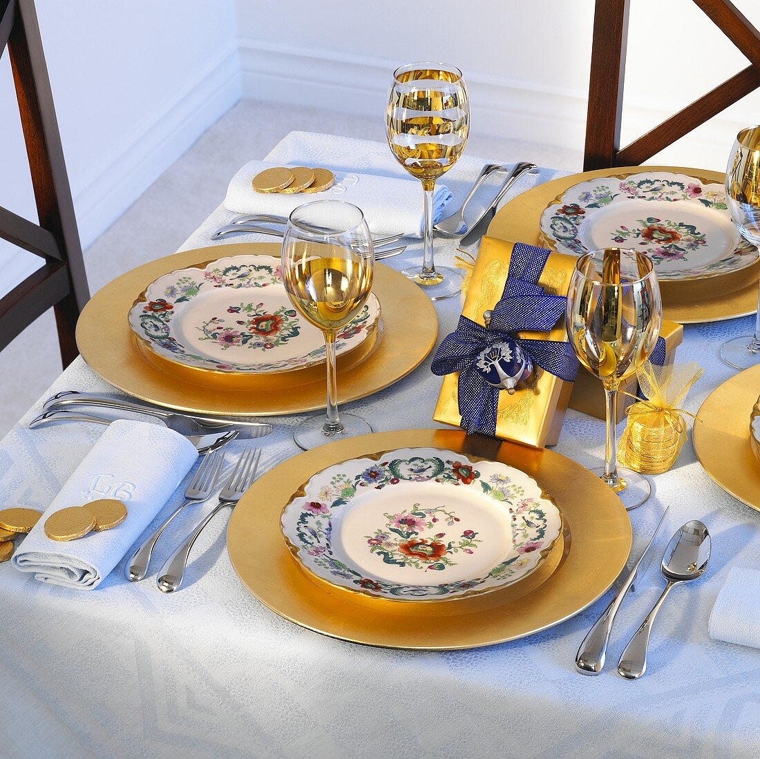 Christmas table laid in blue and gold
