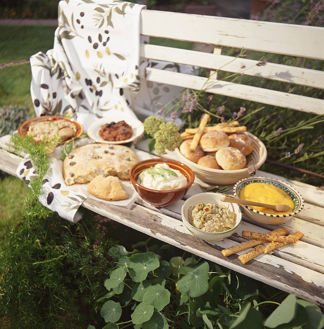 Cold buffet with Provencal dishes on a bench