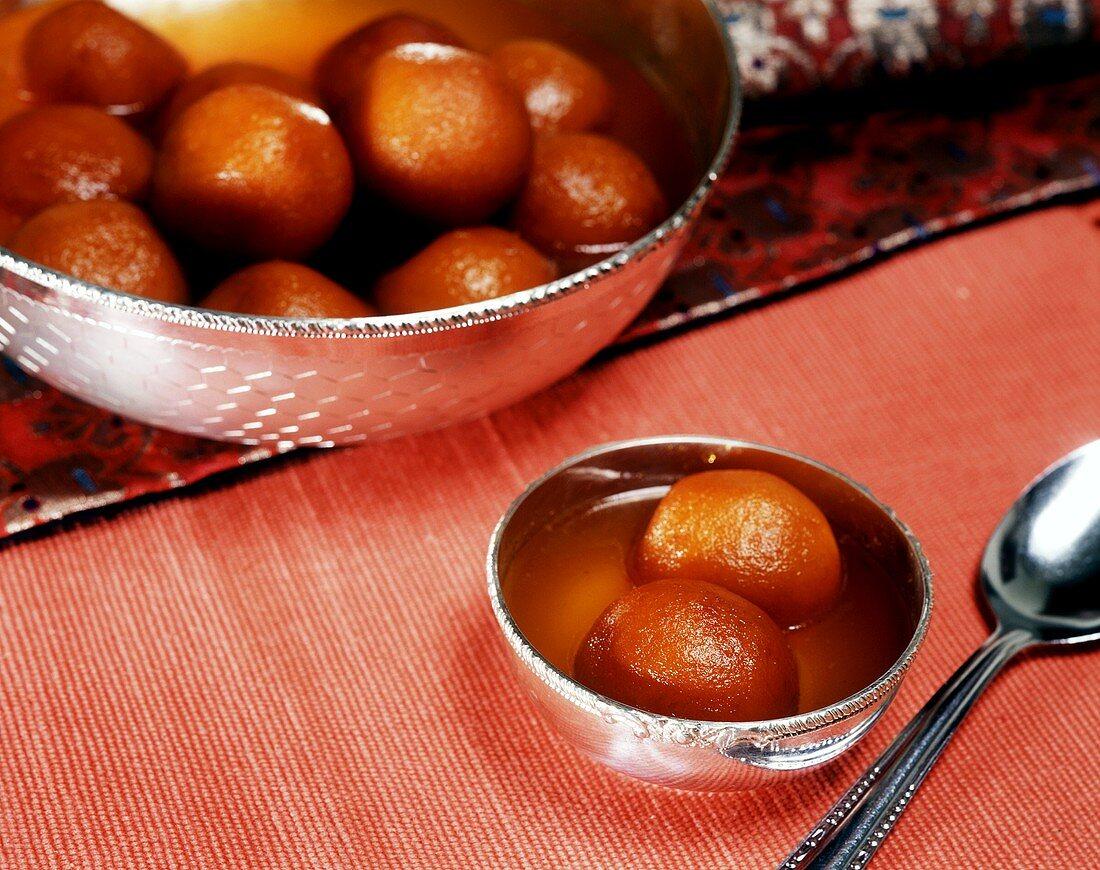 Gulab jamuns - deep-fried Indian milk balls in syrup