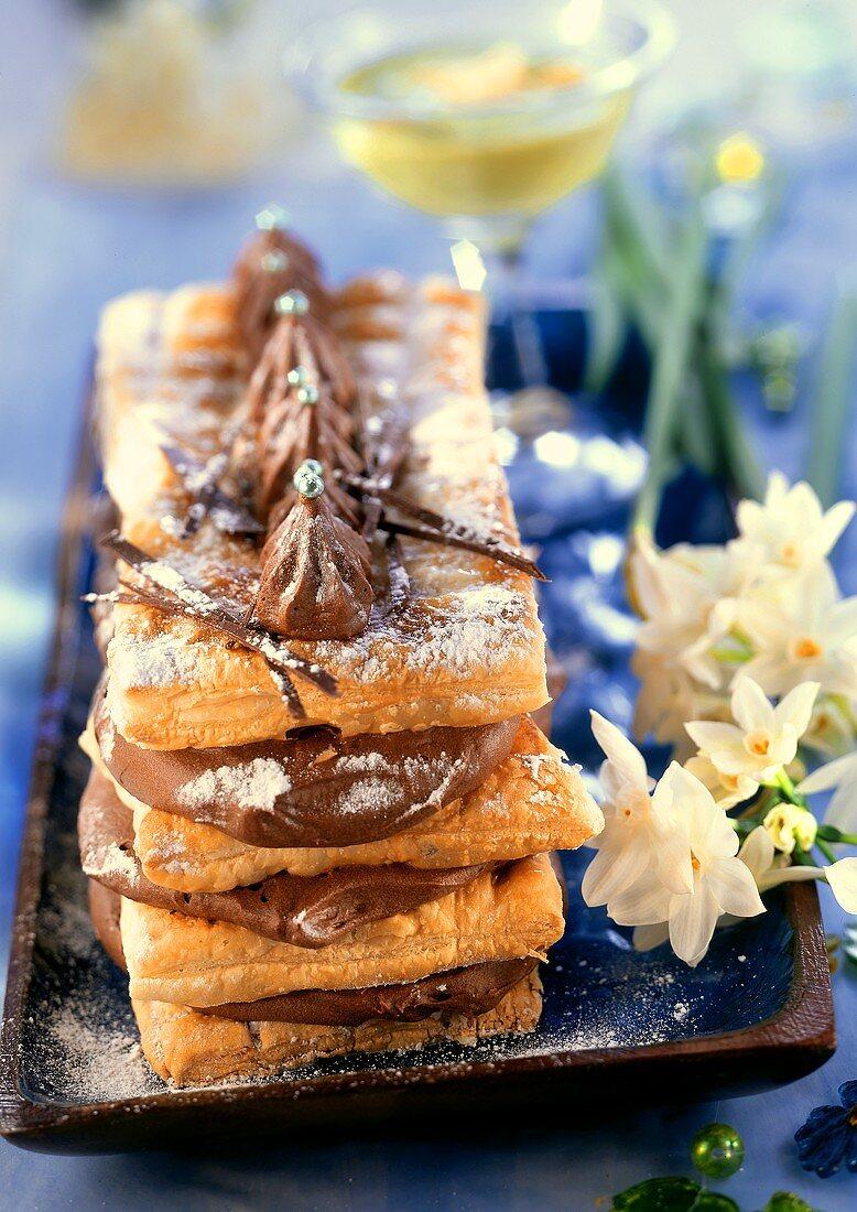 Puff pastry chocolate pie, pistachio sauce behind