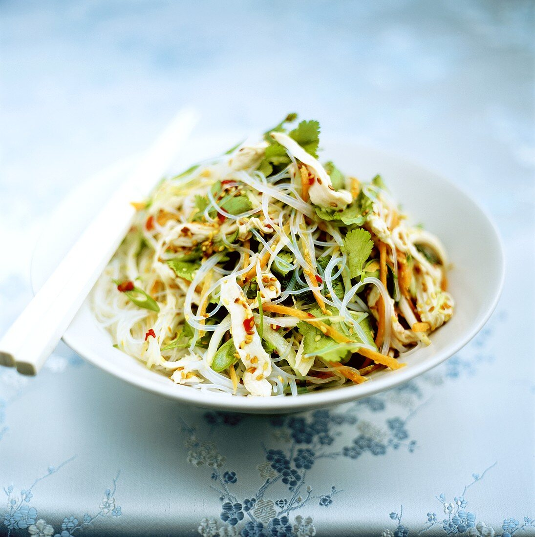 Spicy glass noodle salad with  chicken & coriander leaves