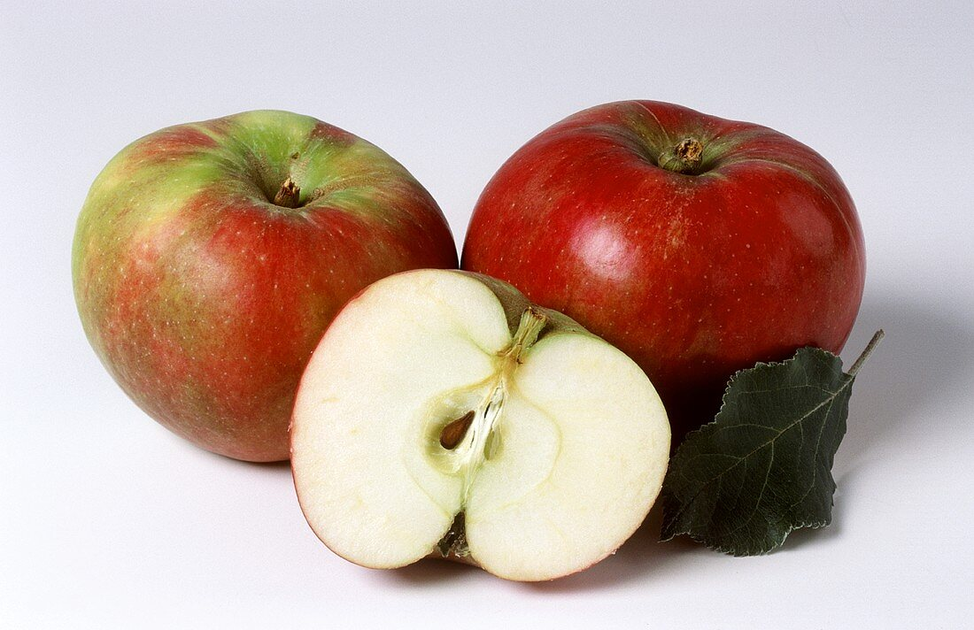 Two whole Ahrina apples and half an apple