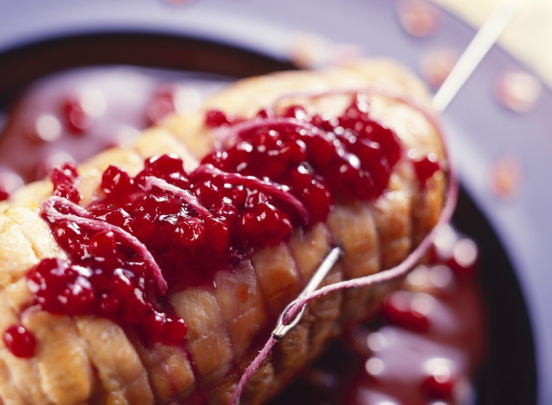 Stitched roast turkey roll with cranberries for Halloween