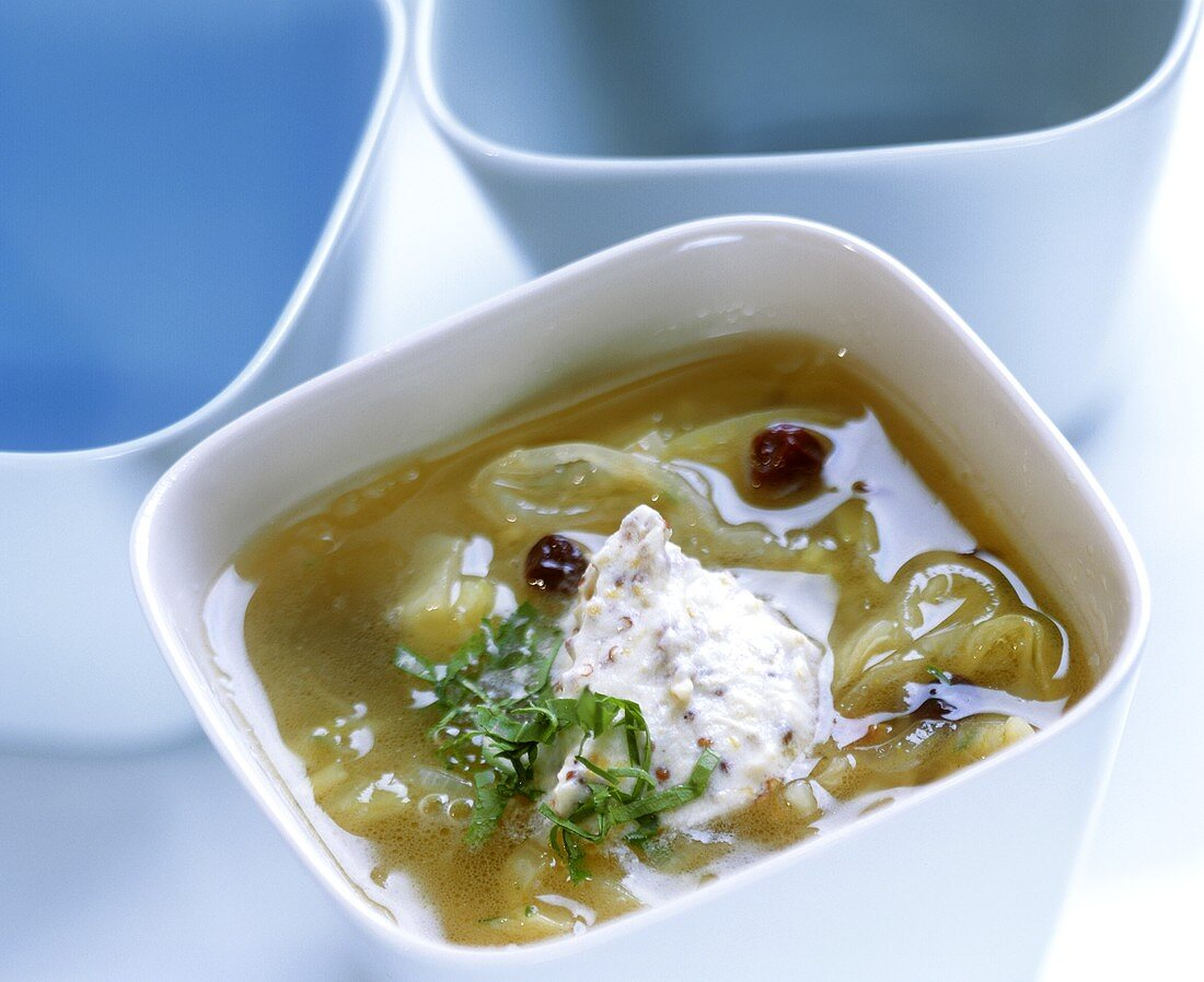 White cabbage soup with mustard cream