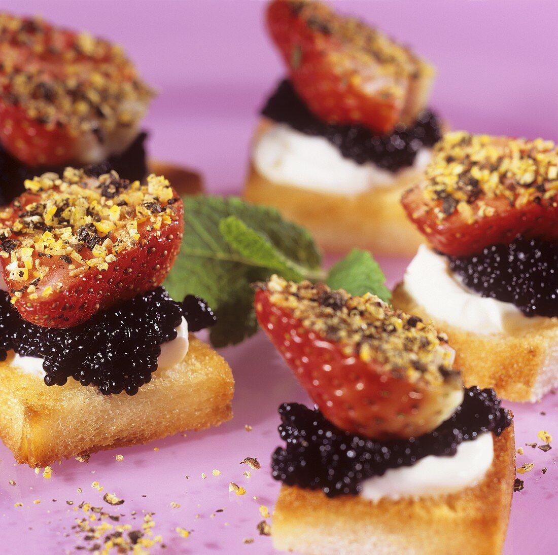 Crostini with caviare, strawberries and black pepper