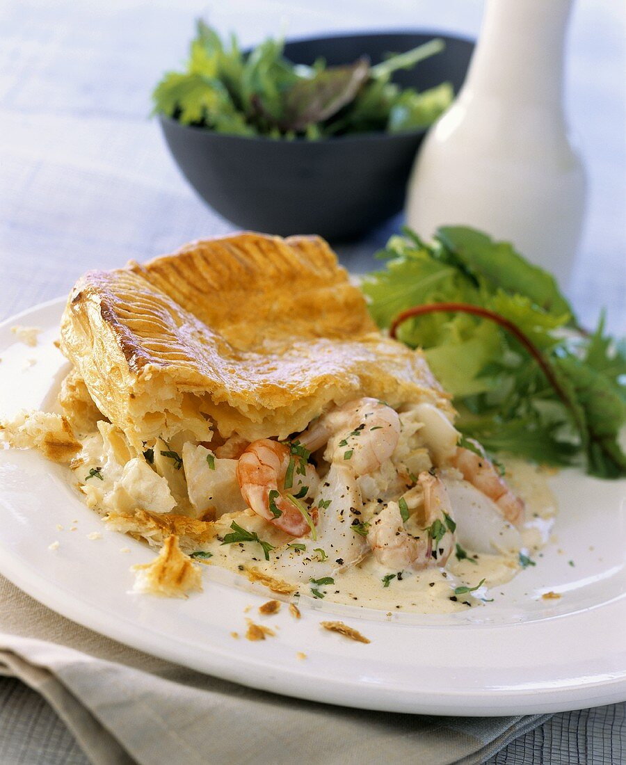 Fish and seafood pie with puff pastry